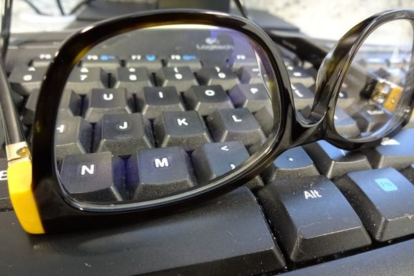 eyeglasses on a keyboard