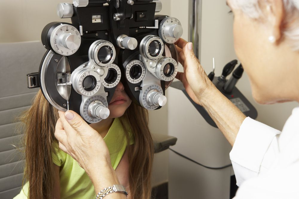 girl having eye check up