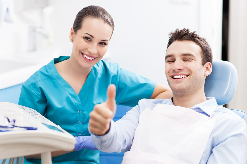 smiling patient with dentist