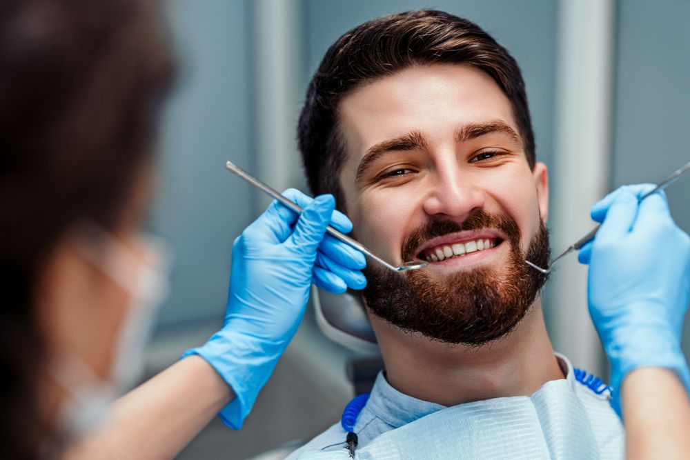 dentists working on young male patient
