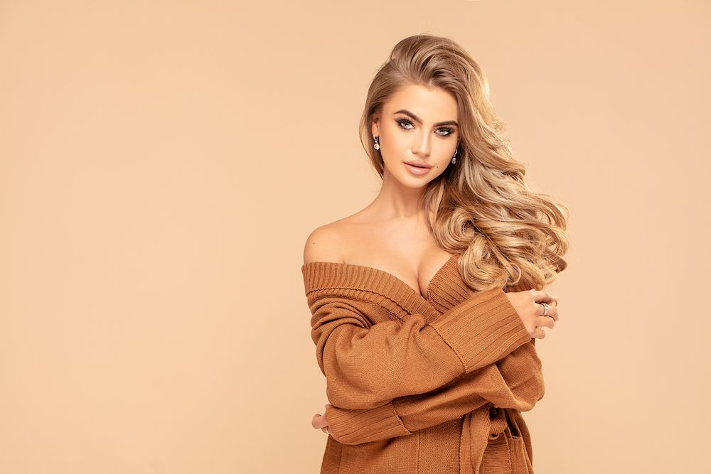 woman in an oversized brown sweater