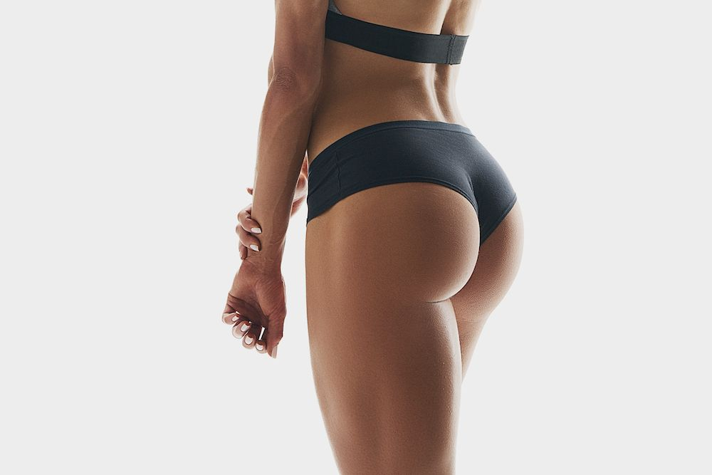 close up of a fit woman's butt in black underwear
