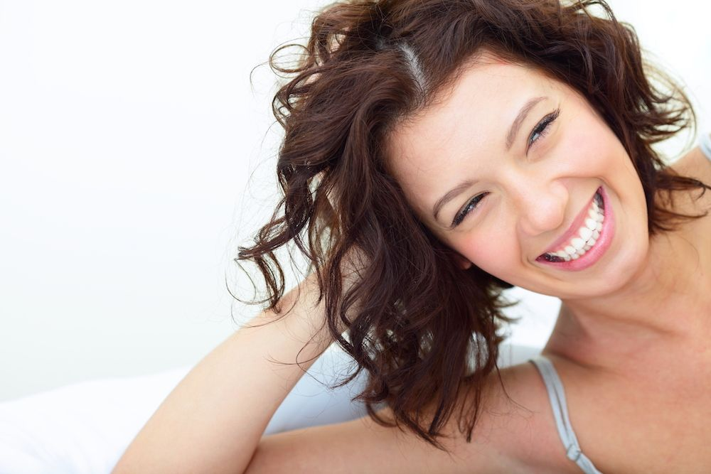 brown haired woman with big smile