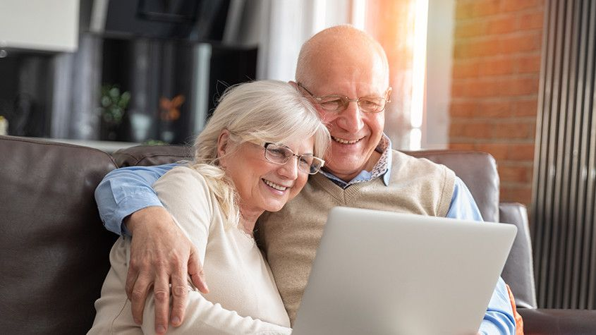old couple reading reviews