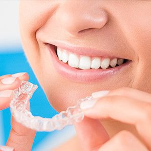 Woman with clear correct braces