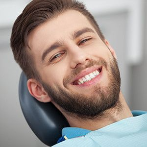 Smiling male patient in dental clinic