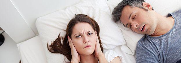 Annoyed woman of snoring man