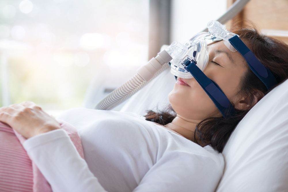 Resting woman with CPAP Machine