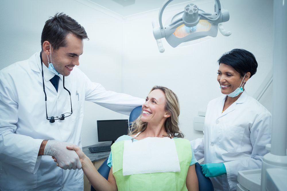 Woman shaking hands with her dentist