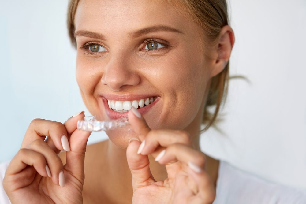 Beautiful woman wearing invisalign
