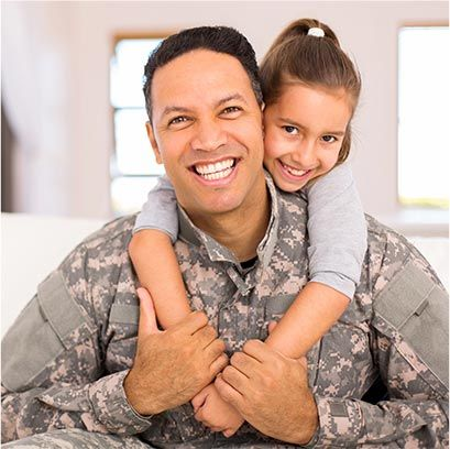 child hugging her military dad