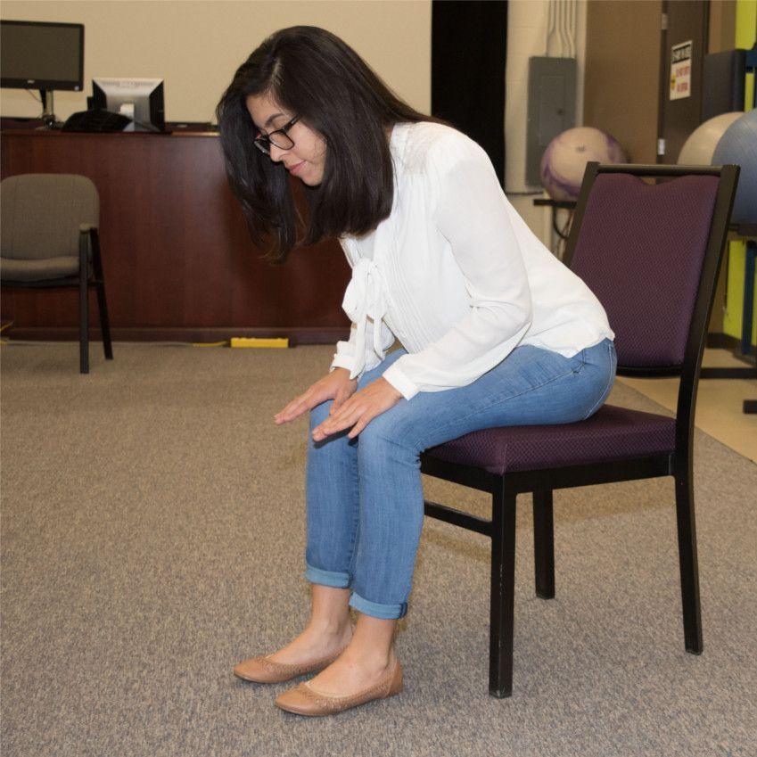 Woman doing forward flexion posture