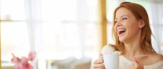 happy woman holding a mug