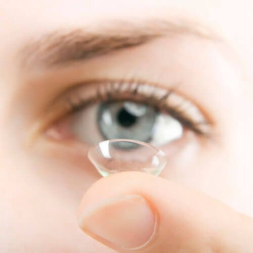 lady holding a contact lens