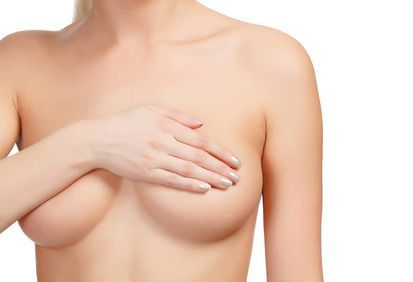 woman covering breasts
