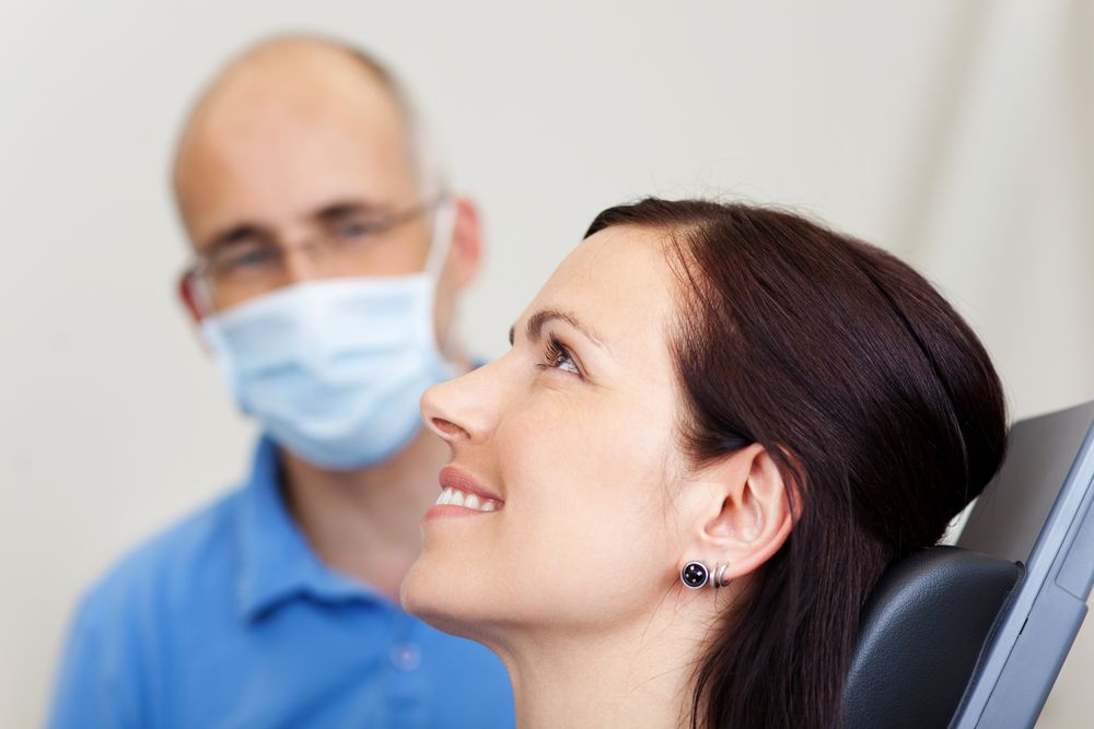 relaxed woman with dentist in clinic​​​​​​​