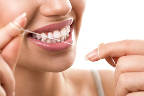 smiling woman floss