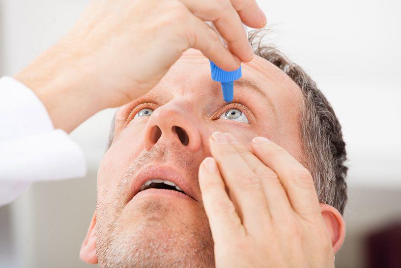 man putting in eye drops