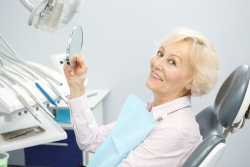 old smiling lady in a dental clinic
