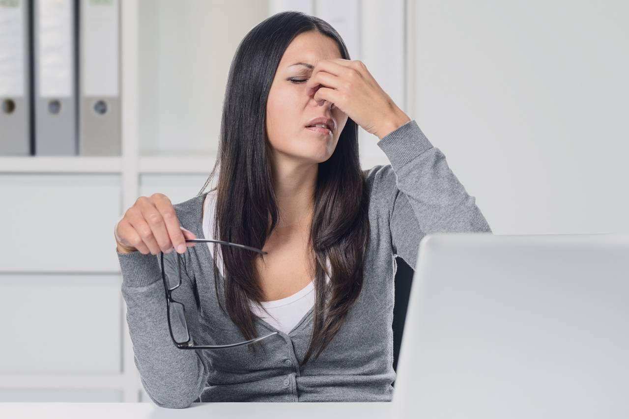 Women Suffering Eyestrain
