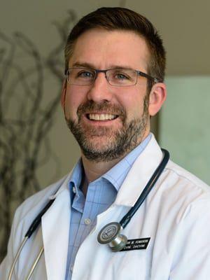 Dr. E. Michael Romansik