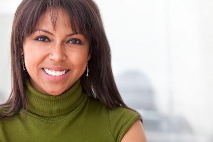 Girl smiling wearing green shirt