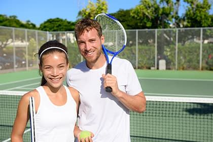 Young couple happy playing tennis