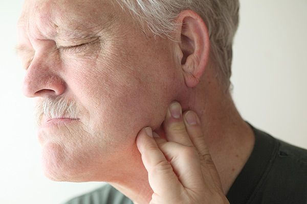 man with TMJ pain