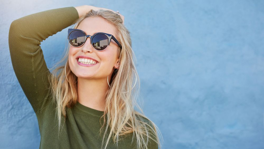 Blonde girl wearing  sunglasses