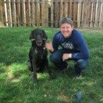 Jay Brekke and a black dog