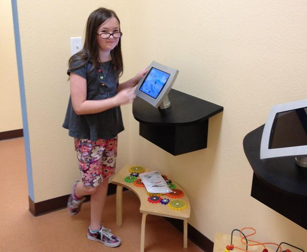 Child with interactive dental technology