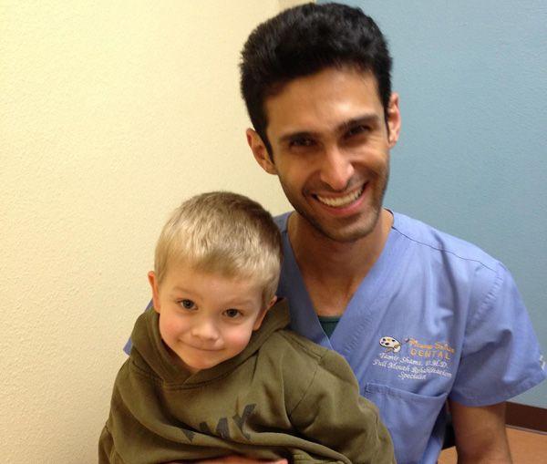 Pediatric dentist with patient