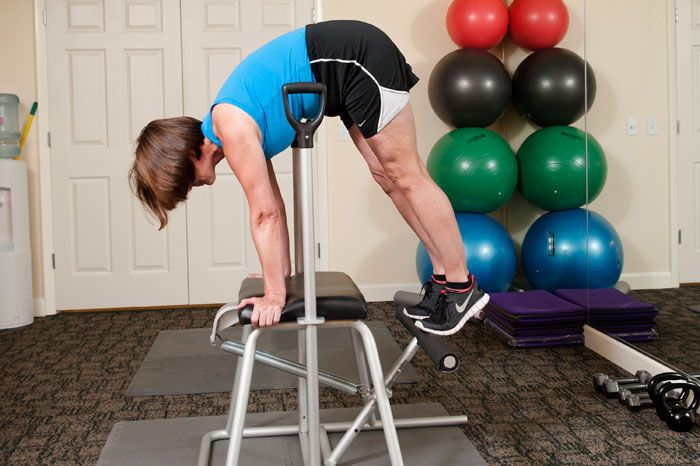 woman on exercise therapy machine