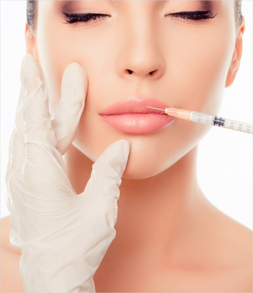 woman's lips enhanced by the plastic surgeon