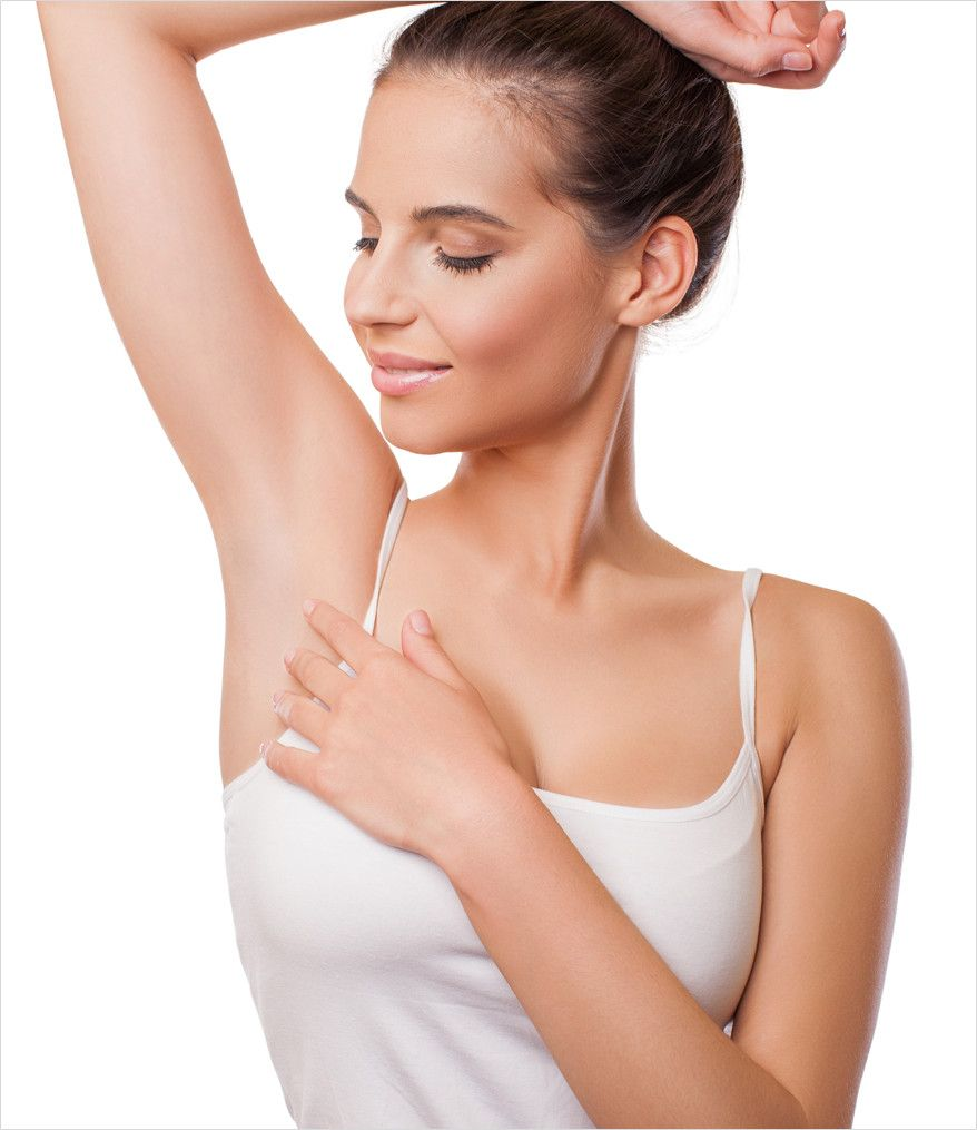 smiling woman looking at her underarm