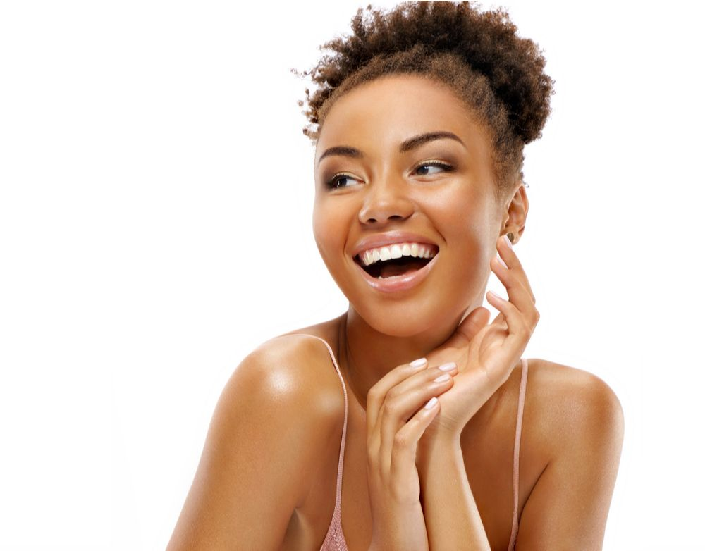 Photo of african american girl laughing with flawless skin.