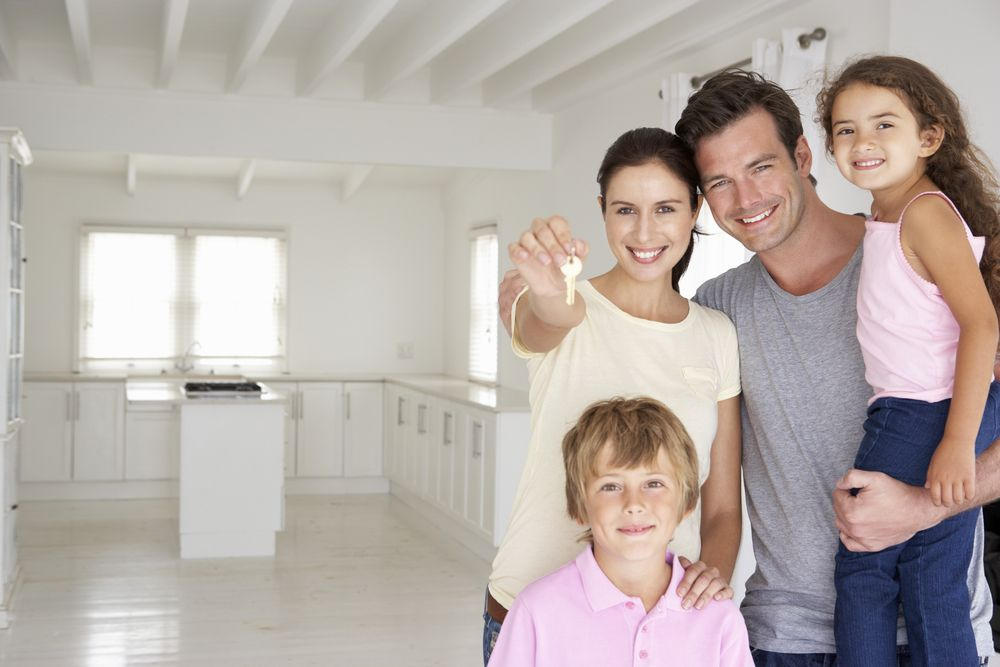 happy family with new home