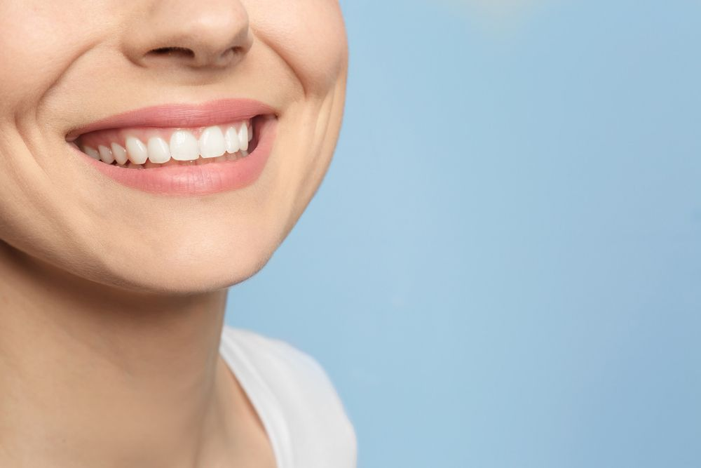 Woman smiling and showing beautiful white teeth