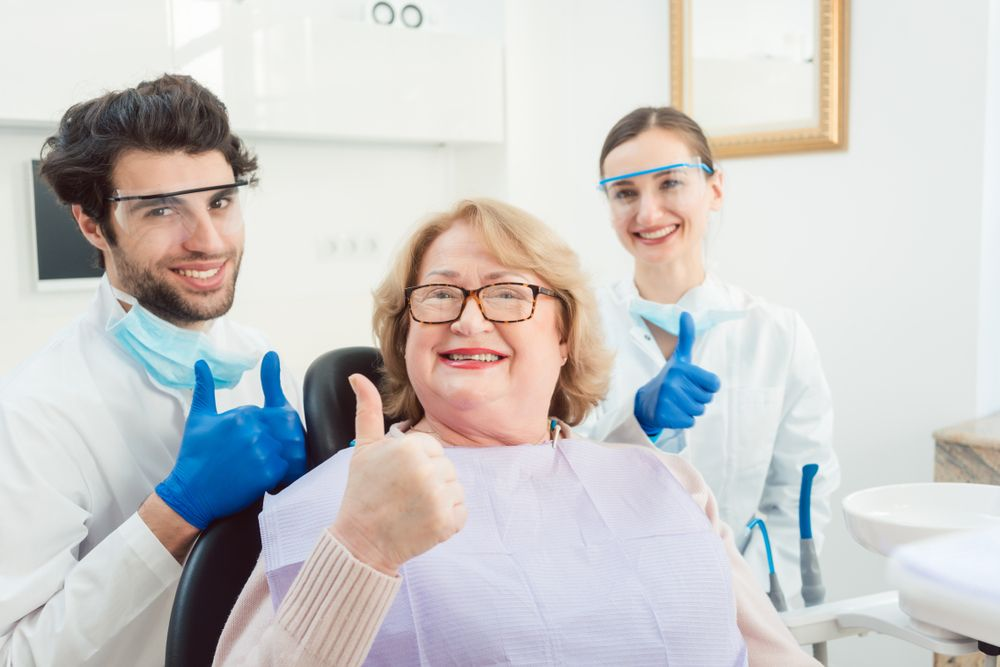happy patient with dentists
