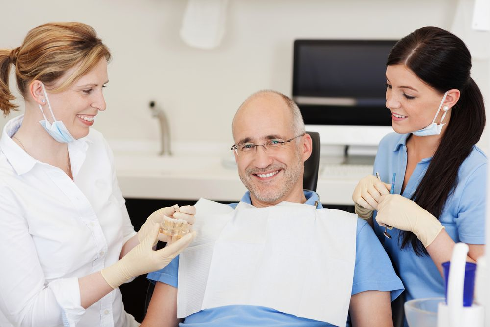 Patient smiling with dentists