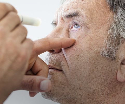 Elderly man getting eye exam