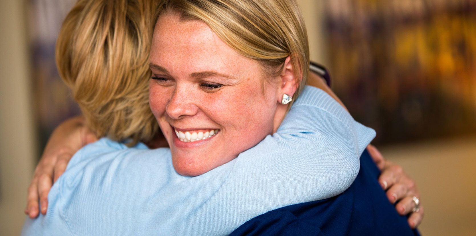 woman hugging her dentist