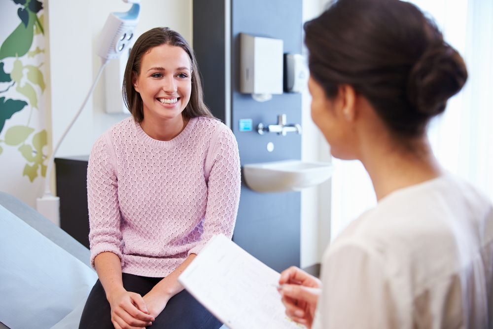 happy woman speaking with surgeon