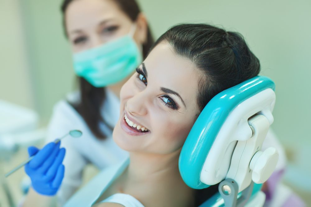 woman with her dentist​​​​​​​
