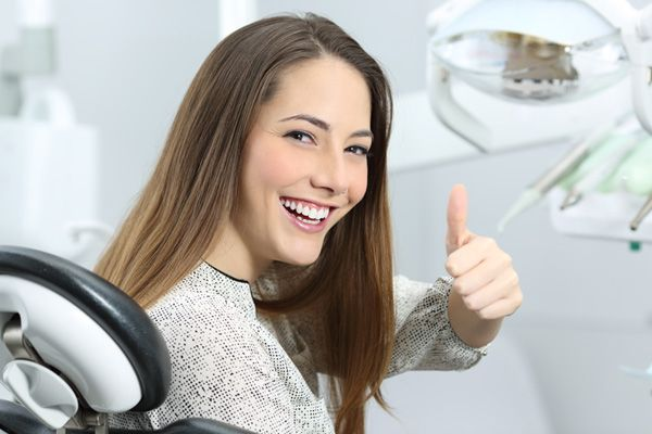 happy woman in a dental clinic
