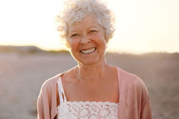old woman smiling in the desert