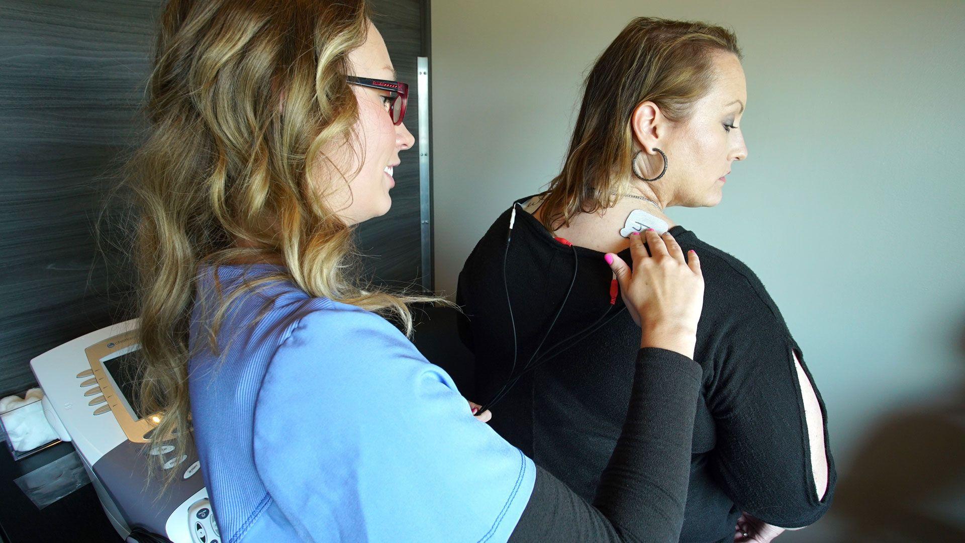 patient and chiropractor