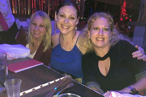 three smiling ladies