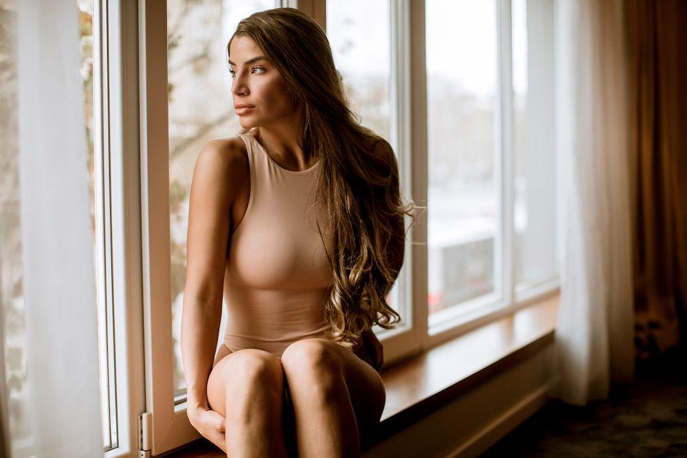 woman in tan bodysuit