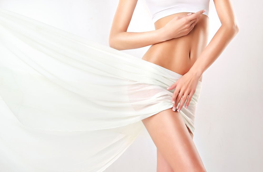 woman with toned body on white cloth